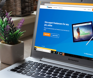 A laptop displaying the Freelancer website in the web browser.