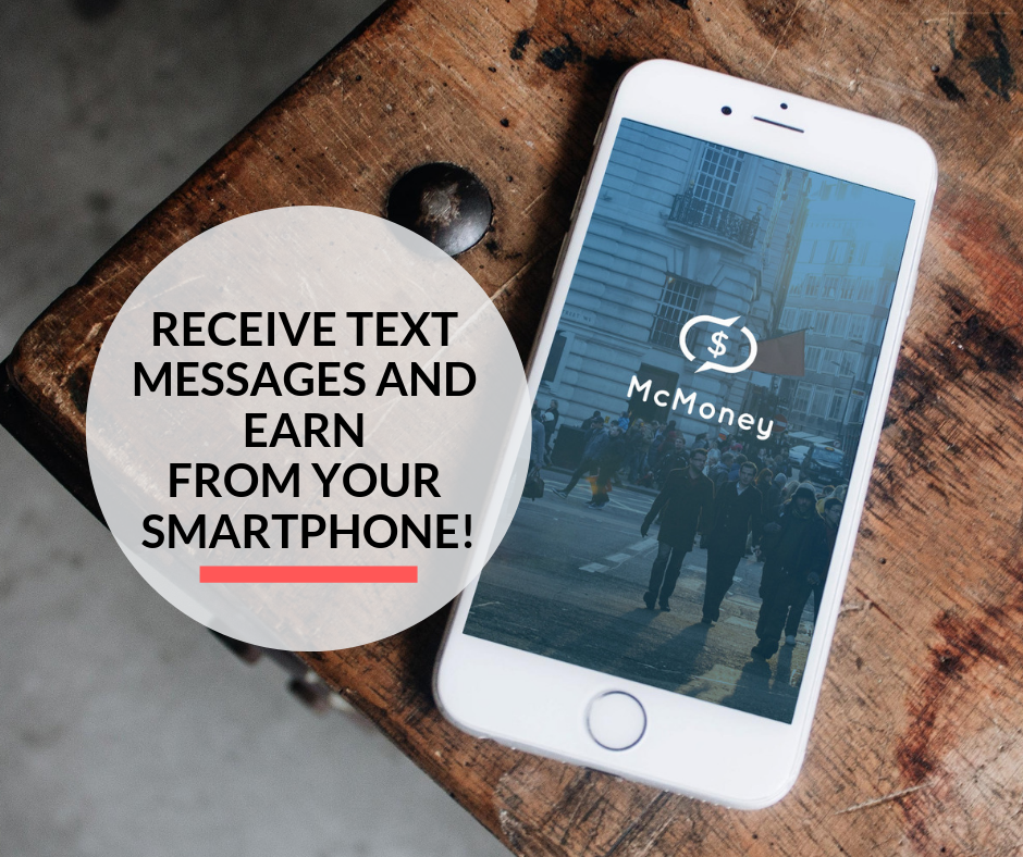 A smartphone on a table displaying the McMoney app.