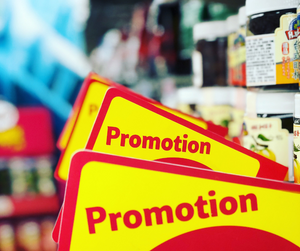Promotion offers in a supermarket enticing customers to buy in bulk.
