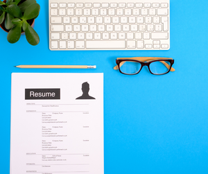A resume lying on a work desk of an office.