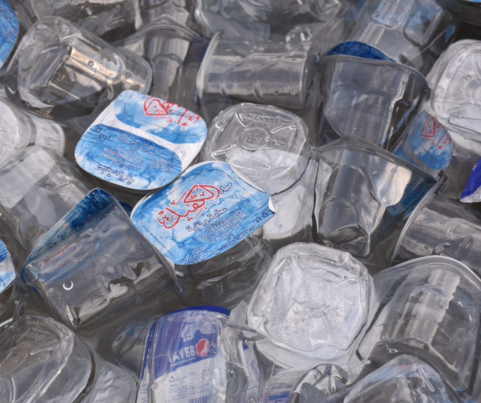 Empty plastic cups of water trashed in the bin.