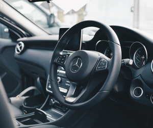 Interior of a Mercedes vehicle demonstrating money spent on expensive cars to live beyond ones means.