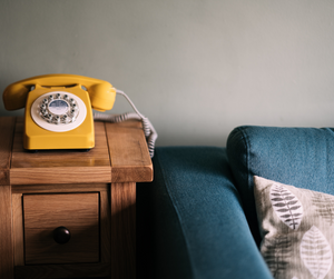A phone besides a sofa at the home of a candidate preparing for a phone interview.