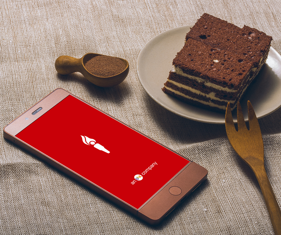 A screenshot of the Dubizzle App on the smartphone along with a Chocolate Cake.