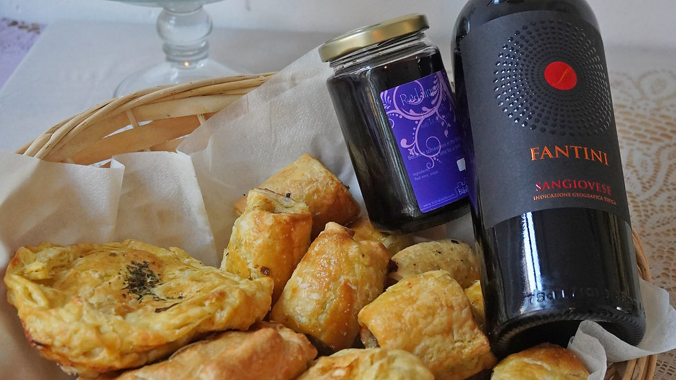 Pies and sausage rolls basket with red wine and wine jelly