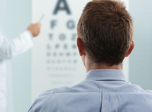 Optometrist and patient, doctor pointing