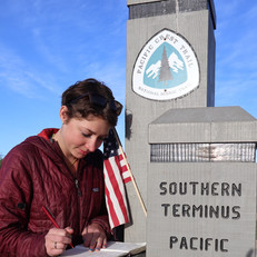 Courtney Signing the Terminus Trail Log