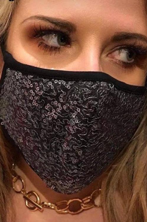 Masque noir à paillettes argentées