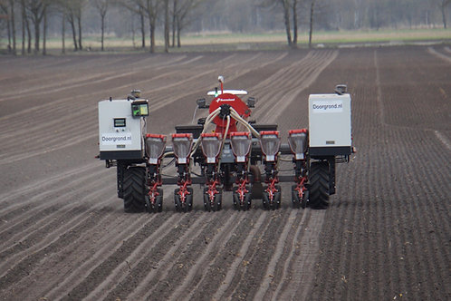 Rear-view on robotti sowing in the field