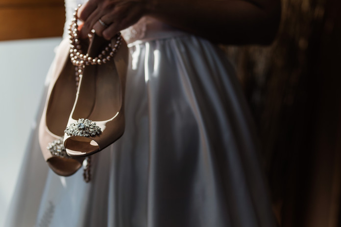 Shoes and faux pearl necklace