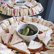 Lovely trays of sandwiches and squares w