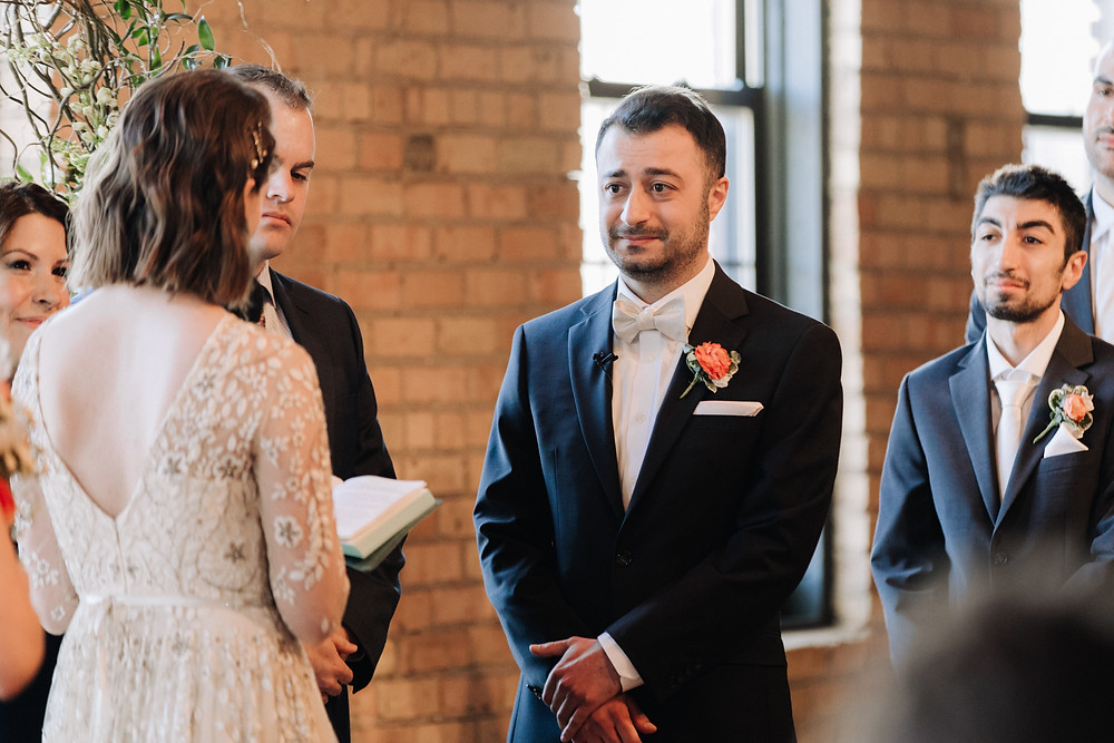 solar arts minneapolis wedding ceremony bride and groom