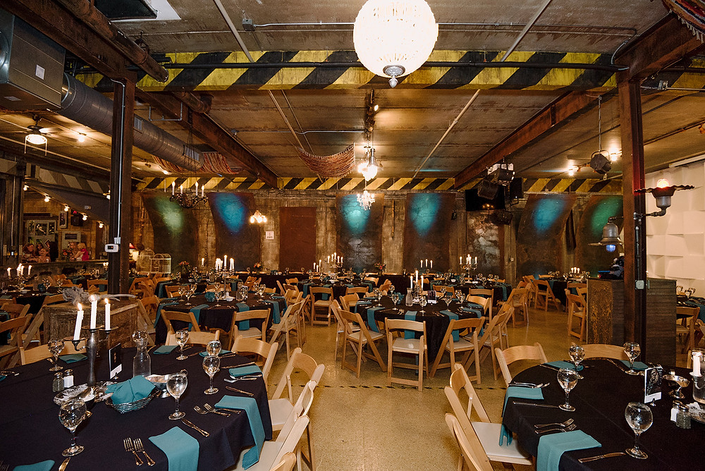 Warehouse Winery wedding reception with black linens