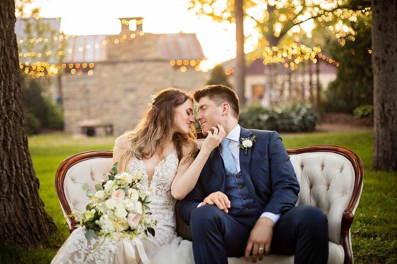 wedding-couple-settee-bouquet.jpg