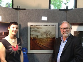brownie harris with dorian hill receiving an award for iphoneography landscape print