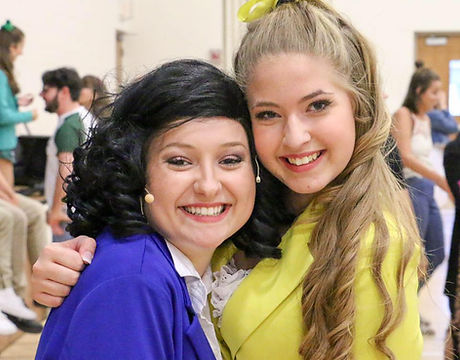 Two leading performers hugging after Heathers 101 performance