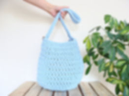 Round crochet bag with pockets