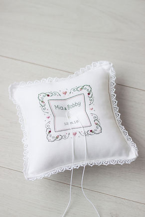 Embroidered white ring pillow
