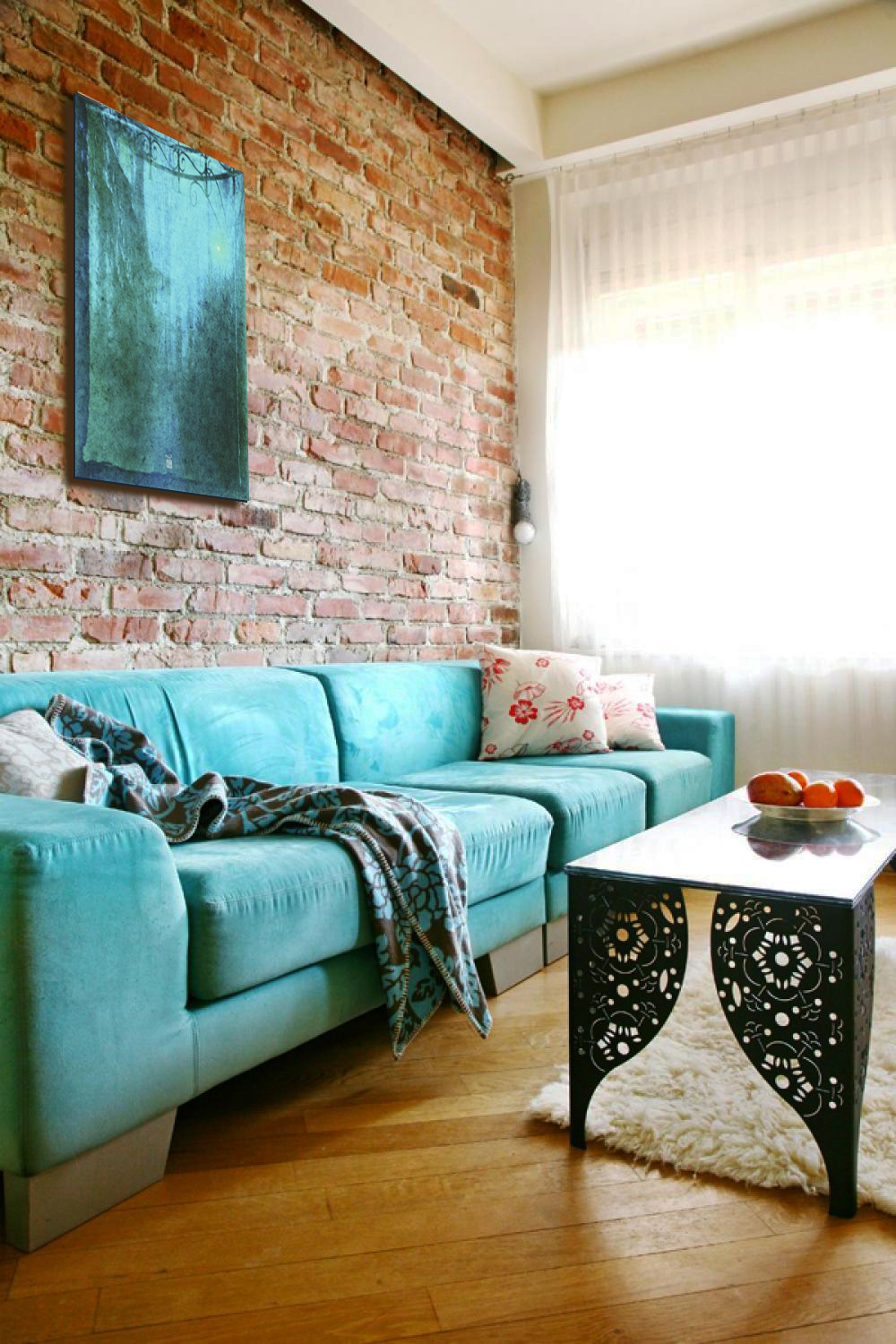 Charming-blue-Sofa-in-Living-Room-with-exposed-brick-wall-look-natural.jpg