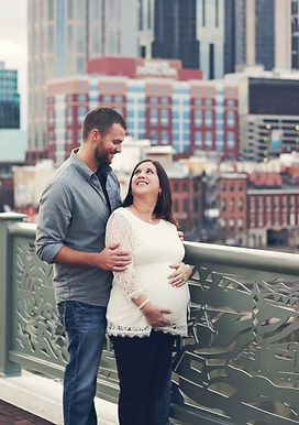 Maternity photo shoot in downtown Nashville Tennessee on pedestrian bridge over cumberland river | Pearl Orchid Photography