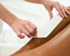 woman-having-hair-removal-procedure-leg-