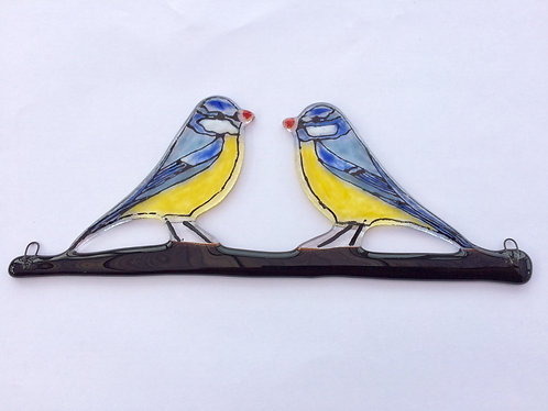 Two Blue Tits Hanging