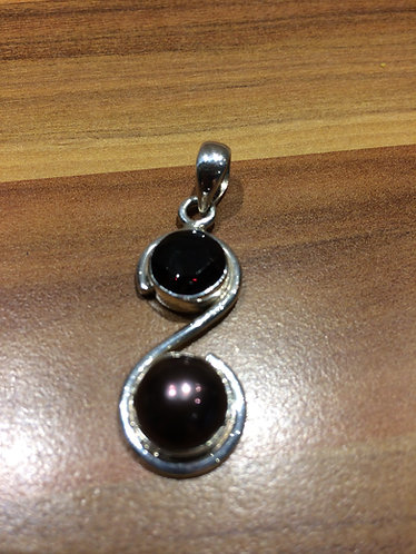 A Small Silver Pendant with Dark Red Garnet & a Dark Purple Pearl