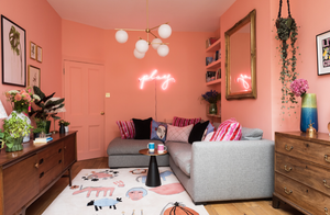 Gorgeous peachy coral Ida paint by Paint House in the Pink House living family room.