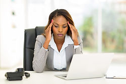 stressed african businesswoman sitting i