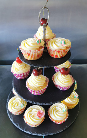 Wedding cupcakes on slate tiered stand