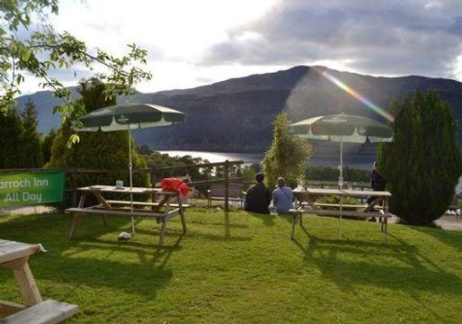 Beer garden at the Craigdarroch Inn with views over Loch Ness