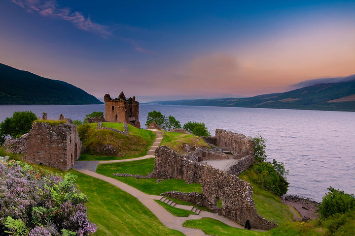 Urquhart Castle at sunset over Loch Ness