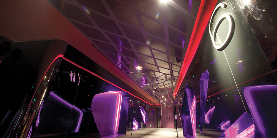 One of the key features within the main circulation of UA Shenzhen. The Red and Purple coloured ceiling is decorated with glass panels with giant snakeskin patterns. Cinema Design by Alexander Wong Architects Limited