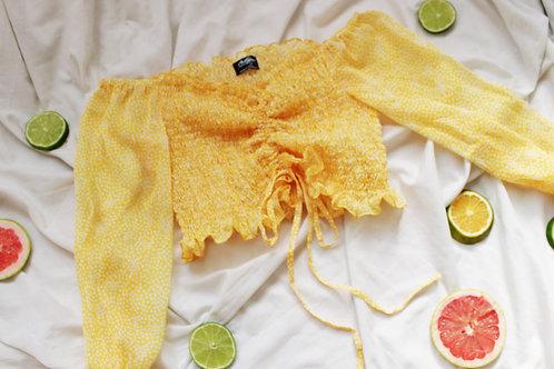Crop top amarillo hilo elastico manga larga, talla S
