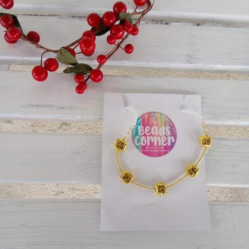 Collar Goldie - Hecho a mano con mostacilla y gold volcanic stones