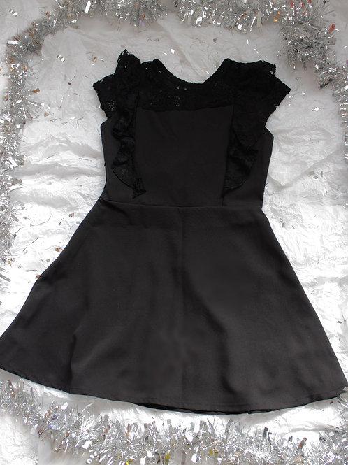 Vestidos negro de tela panamera con manga y olan de encanje