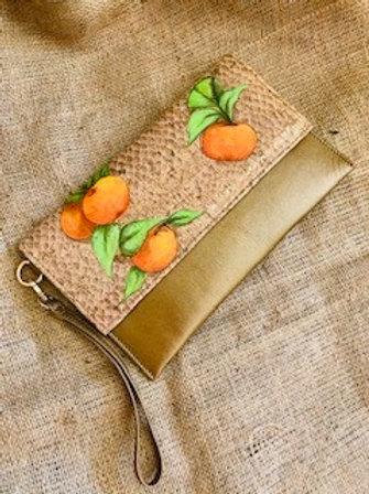 Cartera de mano, cuero y corcho de mandarinas dorada