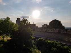 The sun sets over the walls