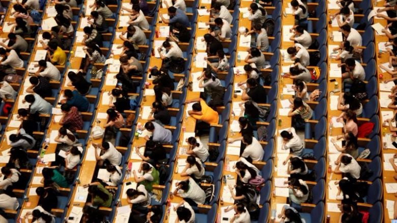 Students attend a lecture for the entrance exam for postgraduate studies at a hall in Jinan, Shandong Province, China, July 18, 2016. China Daily/via REUTERS