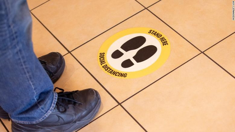Floor decals should help space people out in stores.