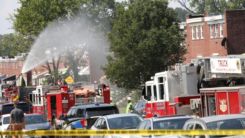 Fire trucks are seen at the scene of an explosion in a residential area of Baltimore, Maryland, U.S. August 10, 2020. REUTERS/Rosem Morton