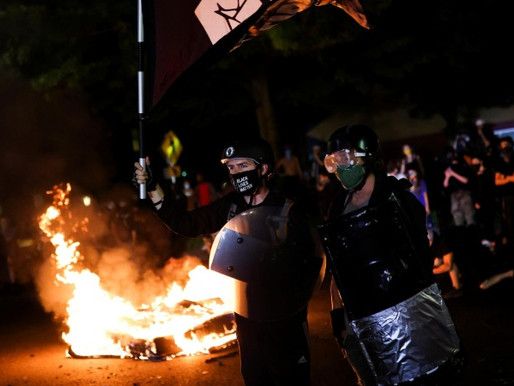 Police arrest 15 more after overnight protests in Portland