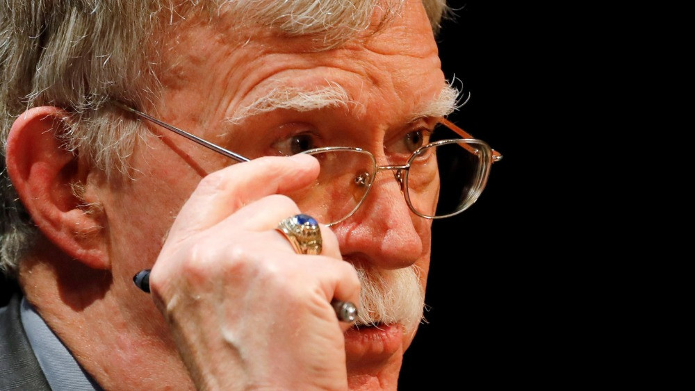 FILE PHOTO: Former U.S. national security adviser John Bolton adjusts his glasses during his lecture at Duke University in Durham, North Carolina, U.S. February 17, 2020. REUTERS/Jonathan Drake