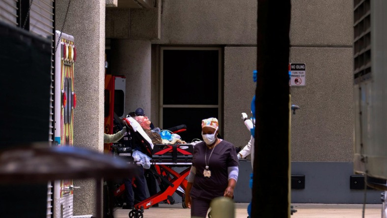 FILE PHOTO: Emergency Medical Technicians (EMT) arrive with a patient to Jackson Health Center, where the coronavirus disease (COVID-19) patients are treated, in Miami, Florida, U.S. July 14, 2020. REUTERS/Maria Alejandra Cardona
