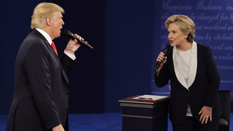 President-elect Donald Trump and Hillary Clinton debate in St. Louis on Oct. 9. The CIA has concluded that the Russians sought to tip the advantage in Trump's favor, a finding that Trump has dismissed. John Locher/AP