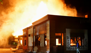 A Wendy's burns following a rally against racial inequality and the police shooting death of Rayshard Brooks, in Atlanta, Georgia, U.S. June 13, 2020.