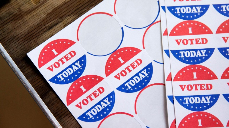 """FILE PHOTO: Stickers saying """"I Voted Today"""" are given out to voters in the Democratic primary in Philadelphia, Pennsylvania, U.S., June 2, 2020. REUTERS/Rachel Wisniewski/File Photo"""