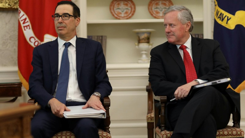 FILE PHOTO: U.S. Treasury Secretary Stephen Mnuchin and White House Chief of Staff Mark Meadows attend a meeting to discuss legislation for additional coronavirus aid in the Oval Office at the White House in Washington, U.S., July 20, 2020. REUTERS/Leah Millis