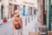 woman tourist walking on the street, summer fashion style, travel to Europe