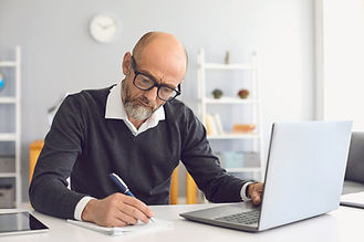 Online education. Mature man with a gray